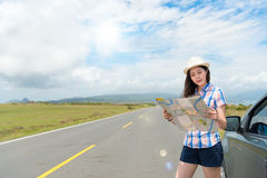 Woman holding paper map finding right route Stock Images