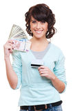 Woman holding paper money and plastic card Stock Photography
