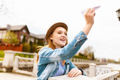 Woman Holding Paper Plane stock photos