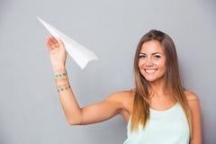 Woman holding paper plane Stock Photo