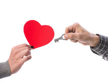 Woman  holding paper red heart, man  holding key Royalty Free Stock Photos