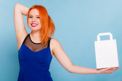 Woman holding paper shopping bag with copy space. Stock Photos