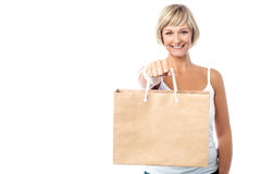 Woman holding paper shopping bag Stock Photo