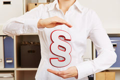 Woman holding paragraph as symbol Royalty Free Stock Photography
