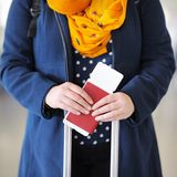 Woman holding passport and boarding pass Royalty Free Stock Photos
