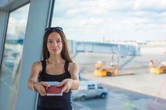 Woman holding passports and boarding pass at Royalty Free Stock Photography