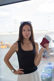 Woman holding passports and boarding pass at Royalty Free Stock Photo