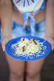 Woman holding pasta plate Royalty Free Stock Images