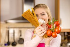 Woman Holding Pasta, Tomatoes And Garlic Stock Photography