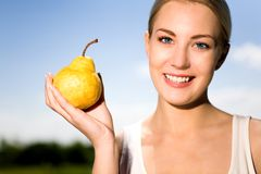 Woman holding pear Royalty Free Stock Photography