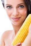 Woman holding a peeled corn cob Stock Image