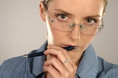 Woman holding a pen Stock Photos