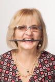 Woman holding pencil Royalty Free Stock Photos