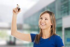 Woman holding a pencil Royalty Free Stock Photos