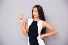 Woman holding pencil Stock Image