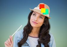 Woman holding pencil with sticky notes stuck on her hat Stock Images
