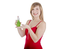 Woman holding perfume bottle Royalty Free Stock Images