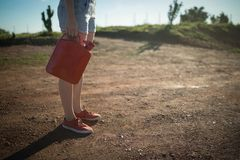 Woman holding a petrol can. On a sunny day stock photos