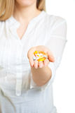 Woman holding pharmaceuticals Royalty Free Stock Photo