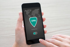 Woman holding phone app vpn creation Internet protocols protecti Stock Photo