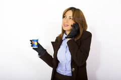 Woman holding phone and coffee Royalty Free Stock Image