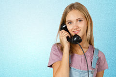 Woman is holding the IT Phone stock images
