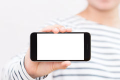 Woman holding phone white screen on hand showing Royalty Free Stock Photography