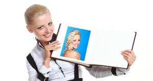Woman holding photo album Stock Images