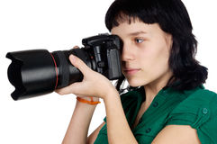 Woman holding a photo camera Stock Image