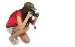 Woman holding a photo camera Stock Images