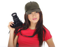 Woman holding a photo camera Royalty Free Stock Image