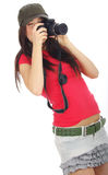 Woman holding a photo camera Stock Photography