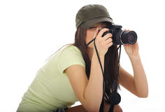 Woman holding a photo camera Stock Photos