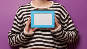 Woman holding a photo frame Stock Images