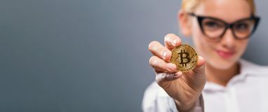 Woman holding a physical bitcoin Stock Photo