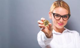 Woman holding a physical bitcoin Royalty Free Stock Image