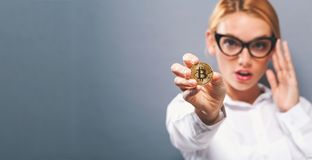 Woman holding a physical bitcoin Royalty Free Stock Photography