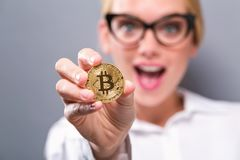 Woman holding a physical bitcoin Royalty Free Stock Photos