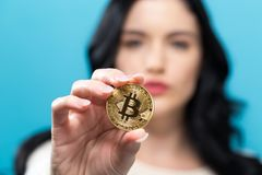Woman holding a physical bitcoin Royalty Free Stock Images