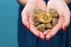 Woman holding a physical bitcoin cryptocurrency. In her hands Royalty Free Stock Photos