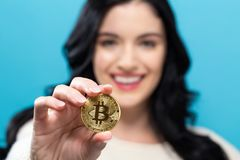 Woman holding a physical bitcoin Royalty Free Stock Photo