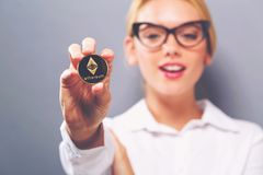 Woman holding a physical Ethereum Royalty Free Stock Photos