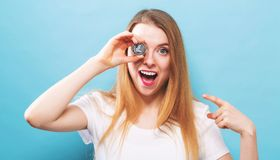 Woman holding a physical Litecoin. In her hand Stock Photos