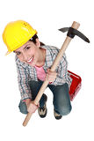 Woman holding pick-axe Royalty Free Stock Photos