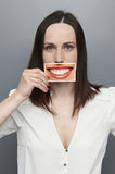 Woman holding picture with big happy smile Stock Images