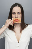 Woman holding picture with big lips Royalty Free Stock Images