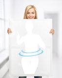 Woman holding picture of dieting woman Royalty Free Stock Images