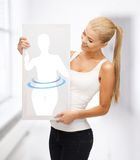 Woman holding picture of dieting woman Stock Photography