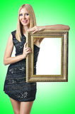 Woman holding picture frame Stock Photography