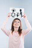 Woman holding picture with happy family Stock Photos
